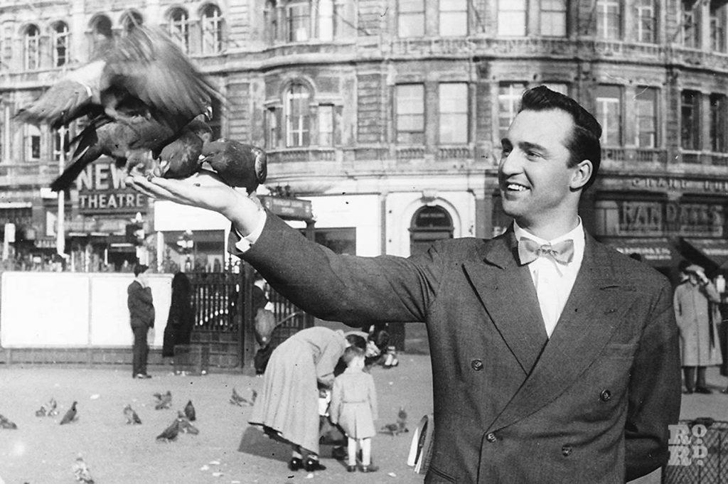 Noel Gibson 1960s feeding pigeons Trafalgar Square