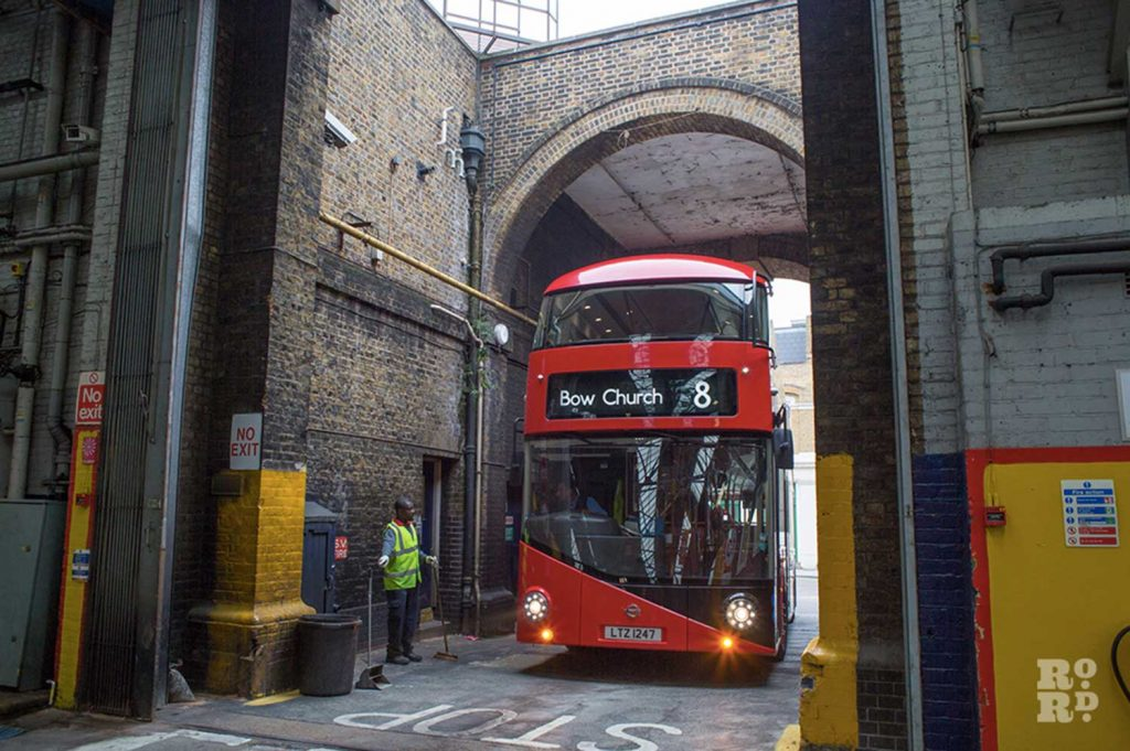 The No 8 new red double decker Routemaster bus entering Bow Garage in East London