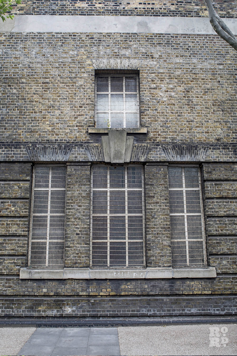 Window in Victorian brick wall made up of London white bricks