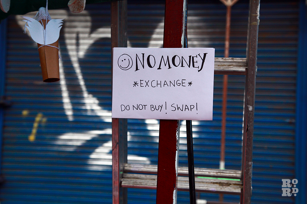 Handwritten sign saying No Money Exchange, Do not buy, Swap.