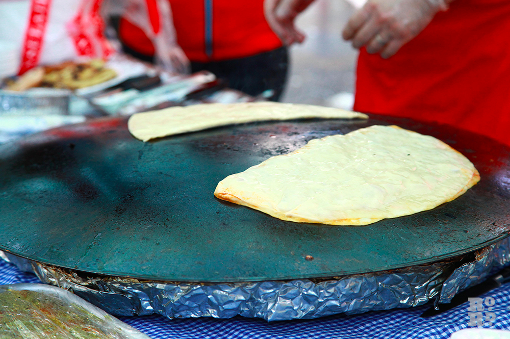 Street food stall cooking Gozleme, traditional Turkish pancakes.