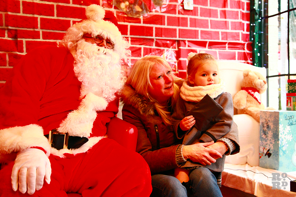 Father Christmas with mother and her child.