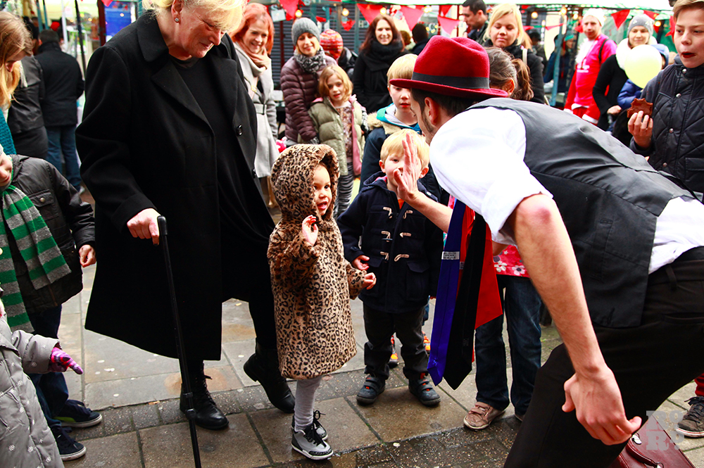 Magician entertaining the children at street festival.