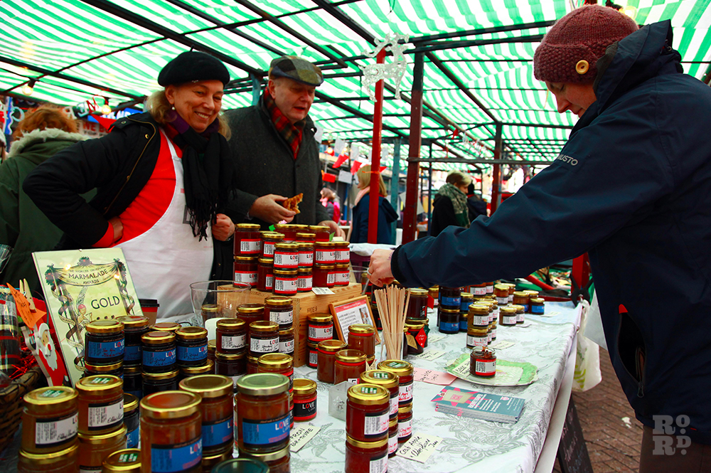 Market stall selling homemade jams and marmalades.