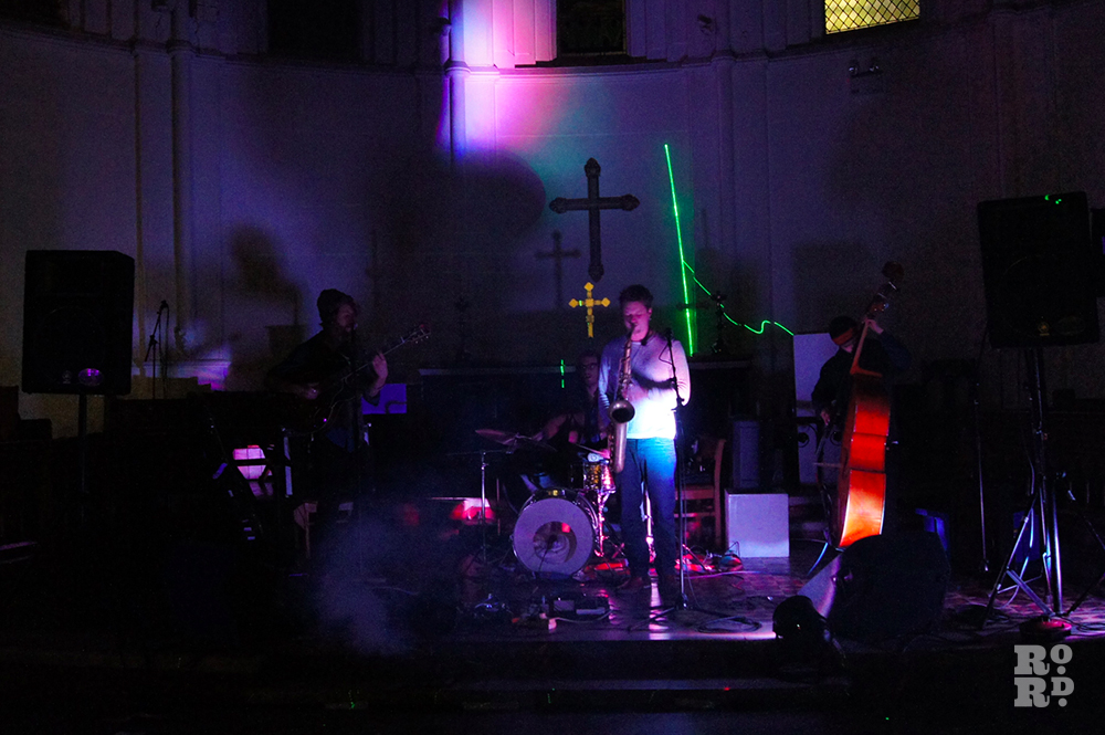 Blind Buffalo music band with cello performing in a Church.