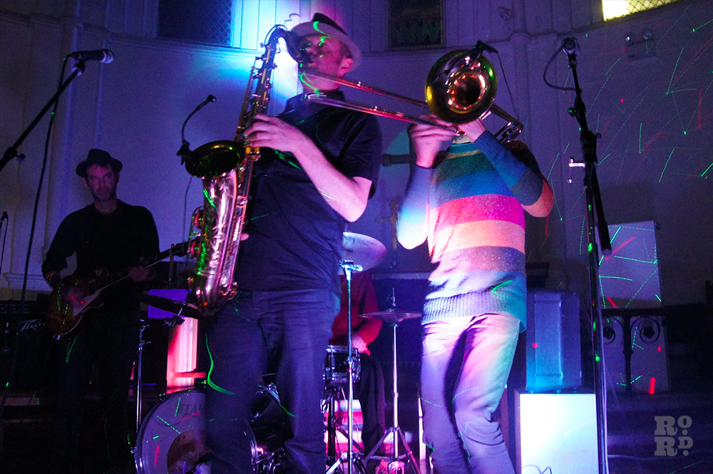 Musicians playing saxophone and trumpet, performing in Church.