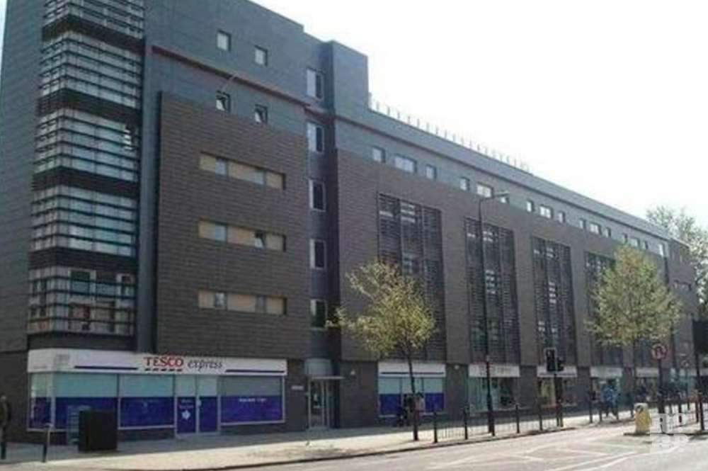 Merchant's Quarter on Bow Road, with Tesco occupying the ground floor retail unit.