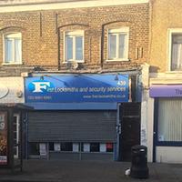 Blue locksmith shopfront in Victorian London terrace