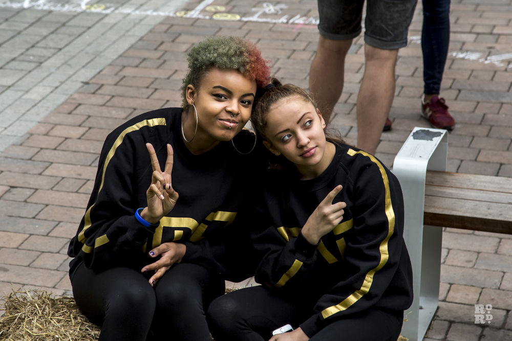 Two girls in black and gold tracksuit from IMD dance crew black