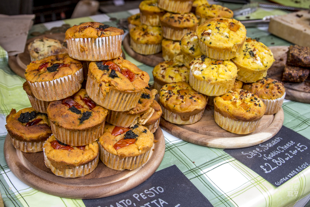 Piles of savoury muffins on market stall