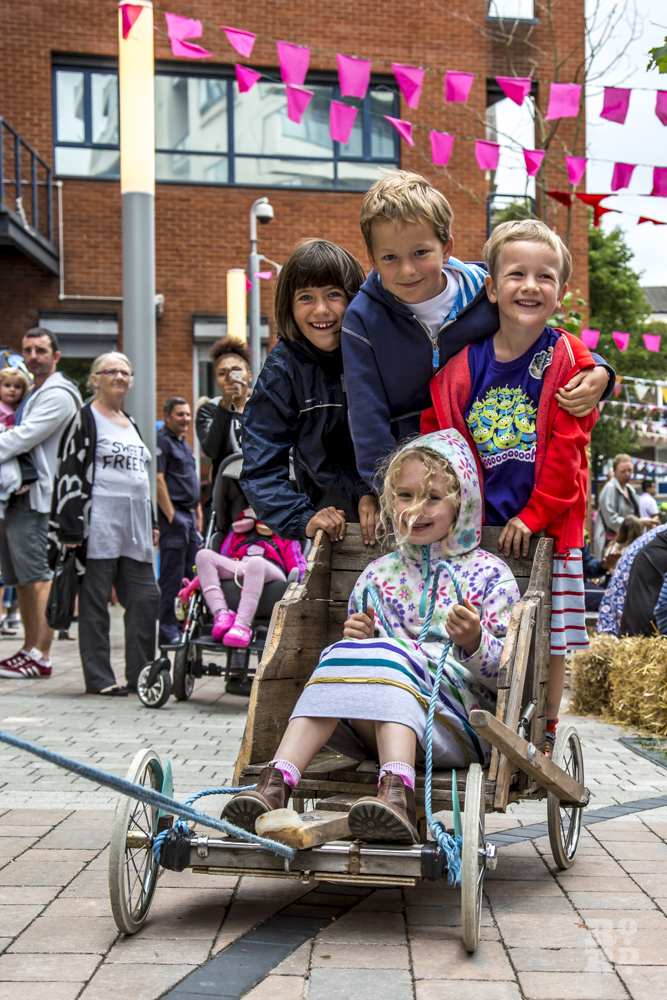 Young boys and girls standing on a cart