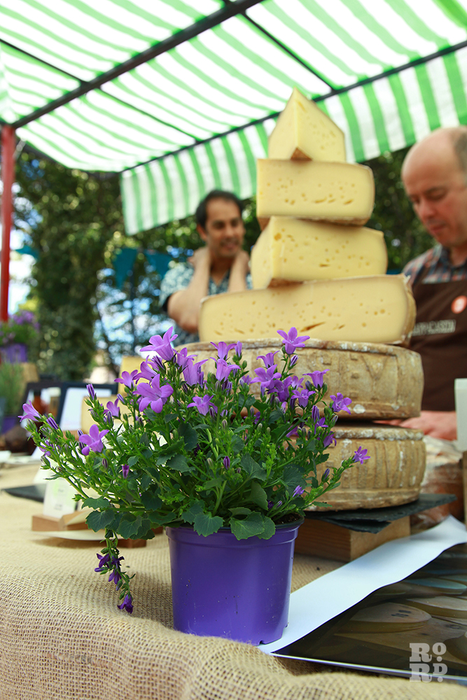 A tower of cheese wheels at Roman Road Festival Food Assembly stall