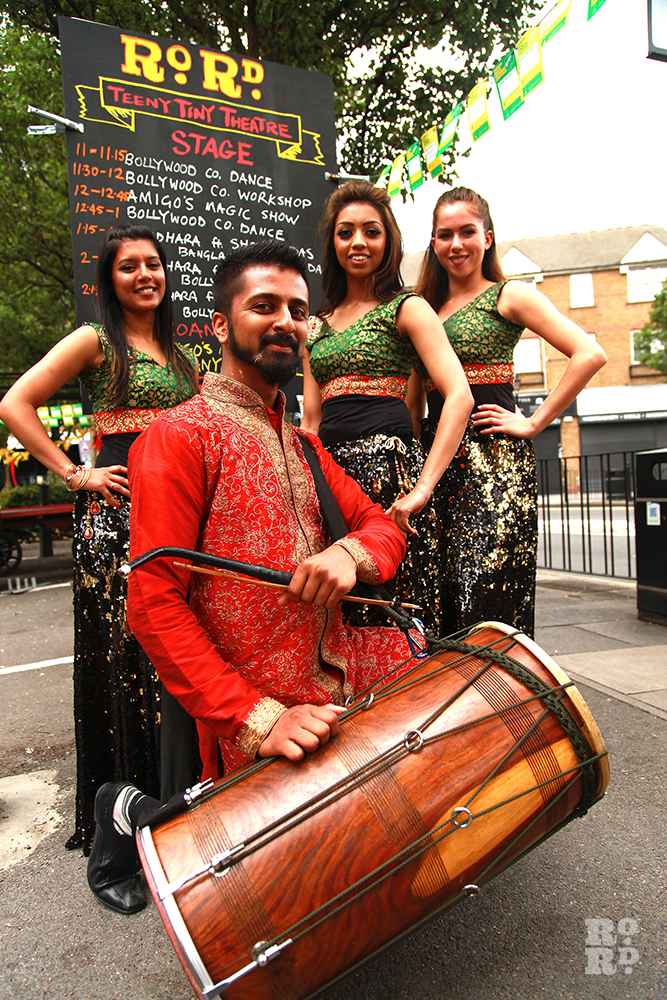 Traditional Bollywood dancers and drummer at Roman Road Festival