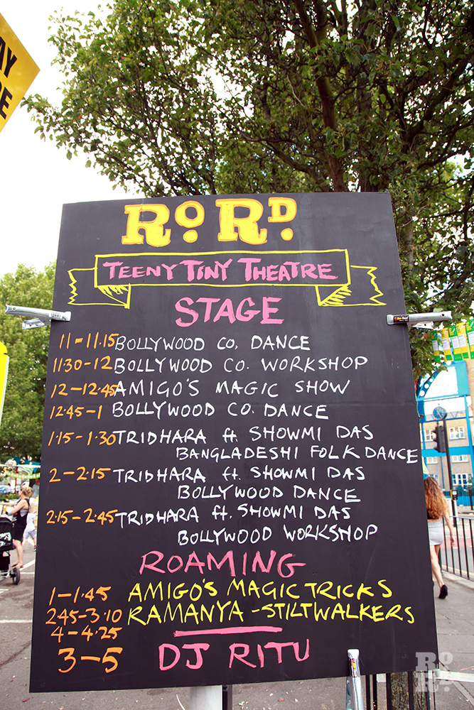Black board painted sign showing what's on at Roman Road Festival Eid Party