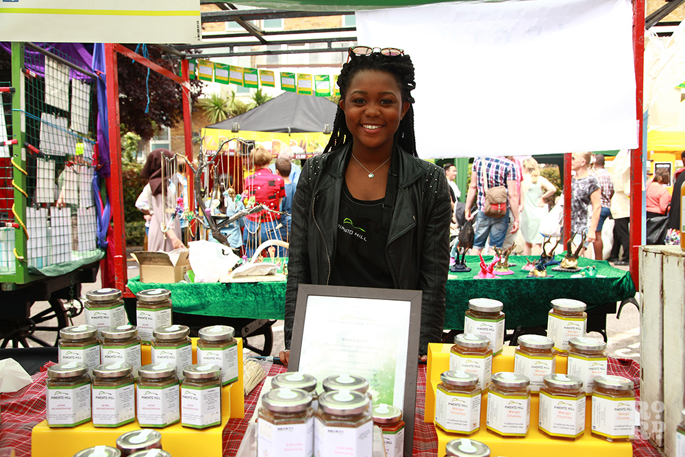Afro Caribbean woman selling jars of chutney at Roman Road Festival
