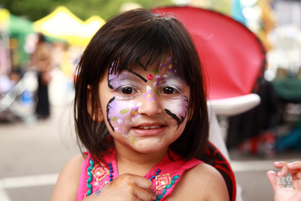 Asian girl with face painting of purple butterfuly
