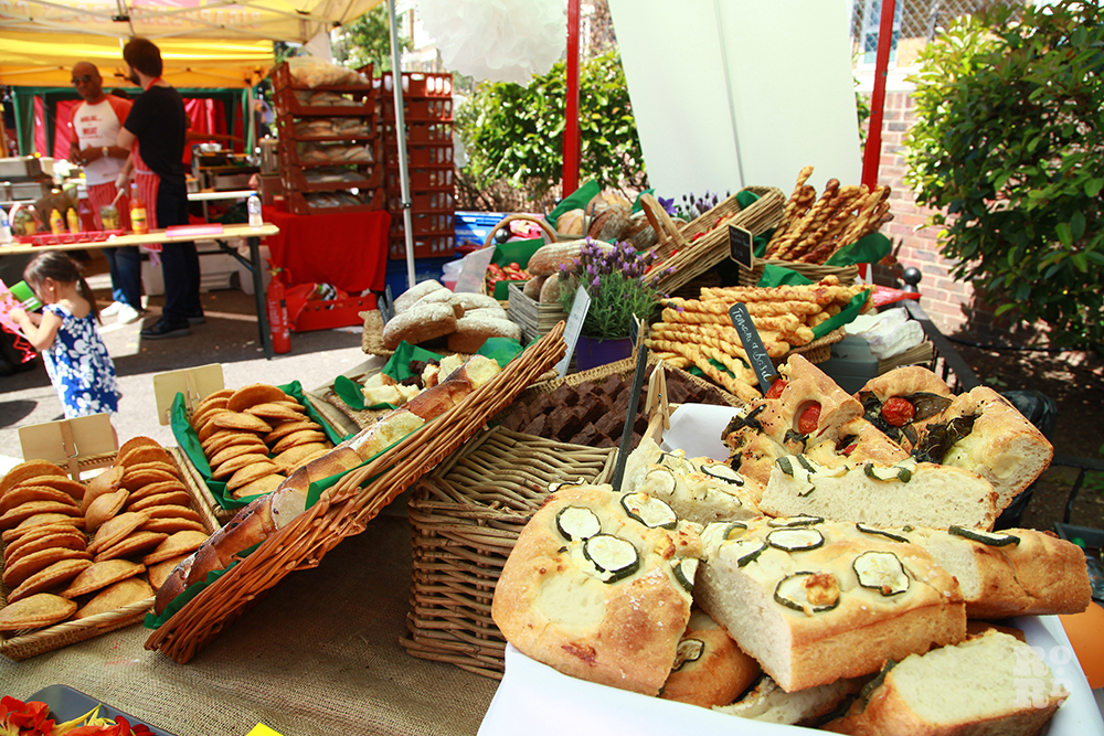 Piles of bread at market stall, Roman Road Festival