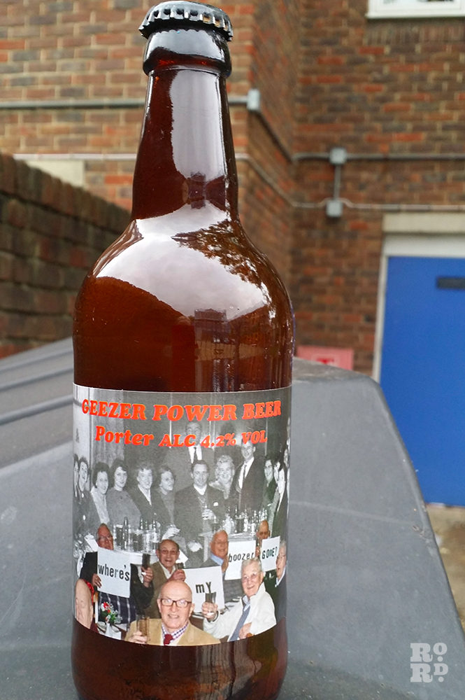 Bottle of beer with Geezer Power Beer label