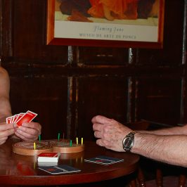 Two nude old men playing cribbage in British pub