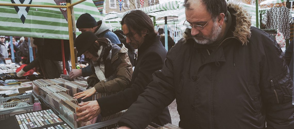 Roman Road Yard Market launch event with customers shopping for vintage vinyl