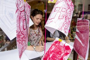 Artists leading marbling worskhop at SNAP shop on Roman Road