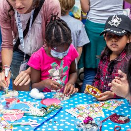 Child with Pearly Queen baseball cap at Roman Road Summer Festival 2016