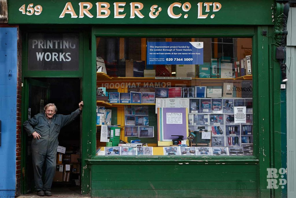 Gary Arber standing outside his stationery shop on Roman Road in June 2014.