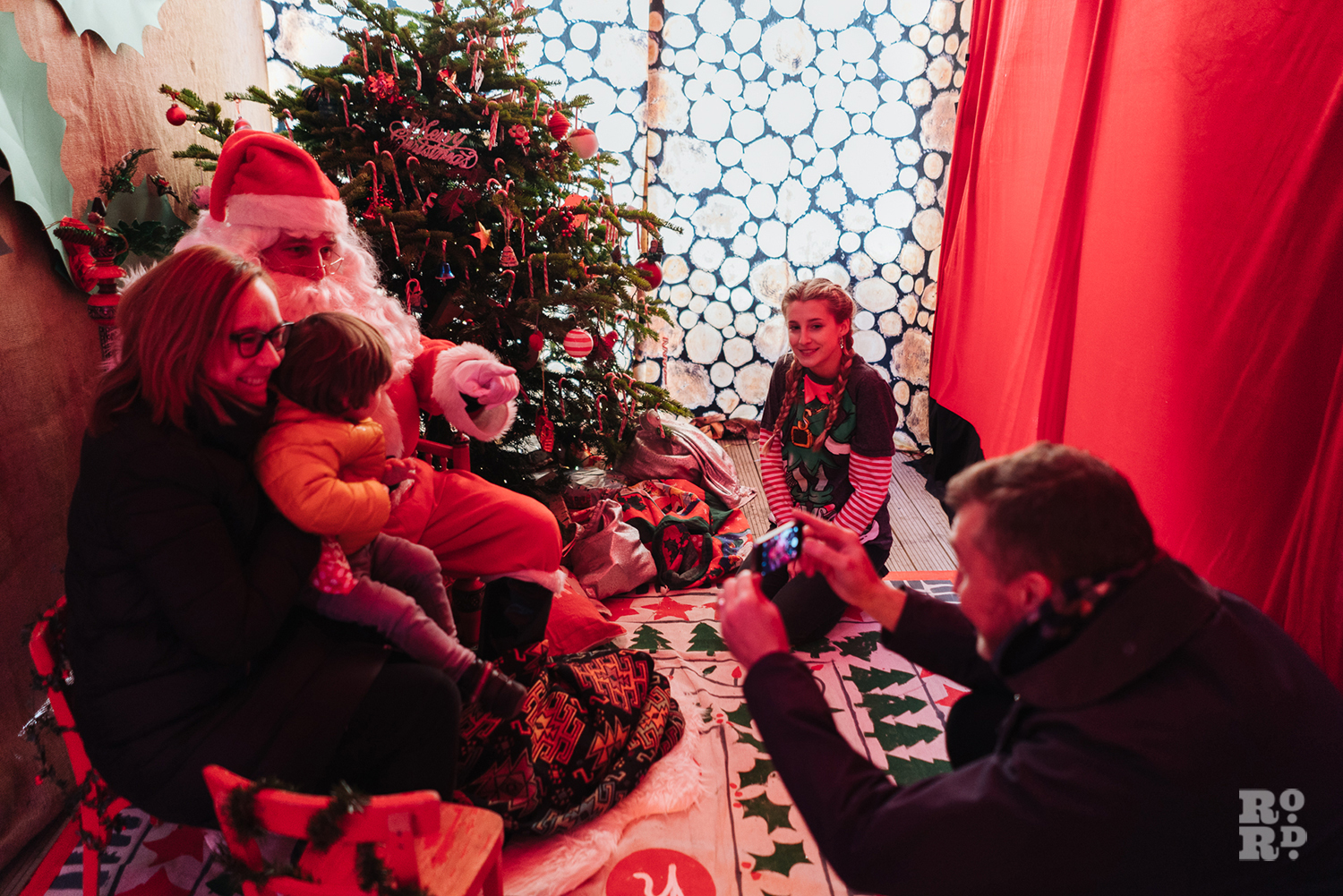Child and parent being photographed at Santas' Grotto Roman Road Christmas Fair 2016 © Roman Koblov