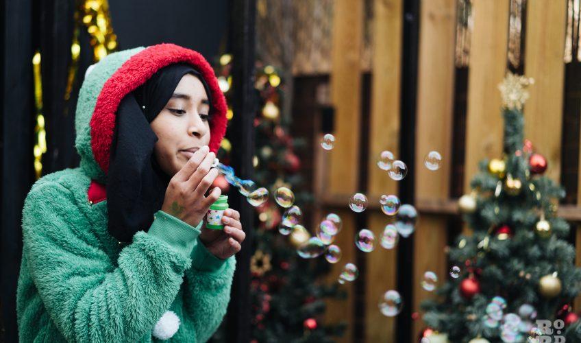 Elf blowing bubbles at Roman Road Christmas Fair 2016