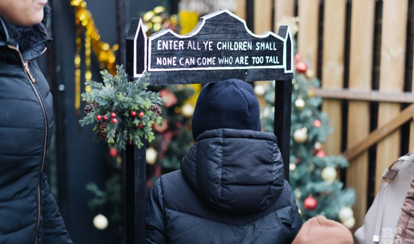 A replica of Clara Grant's arch: Enter all ye children small, None can come who are too tall. Roman Road Christmas Fair 2016