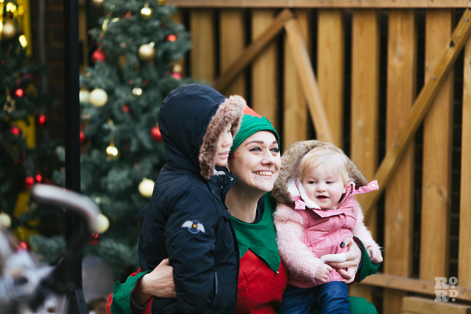 Elf with two children at Roman Road Christmas Fair 2016