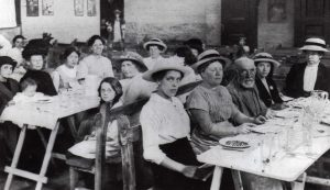 A gathering for a cut price dinner at the East End women's Hall.