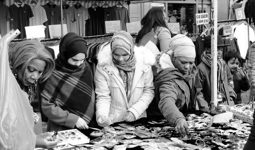 Roman Road Market stall selling jewellery with Aisan and black Afro-Caribbean women shopping
