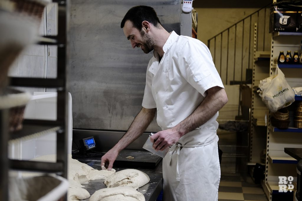 Miller shaping his sourdough. © Tabitha Stapely