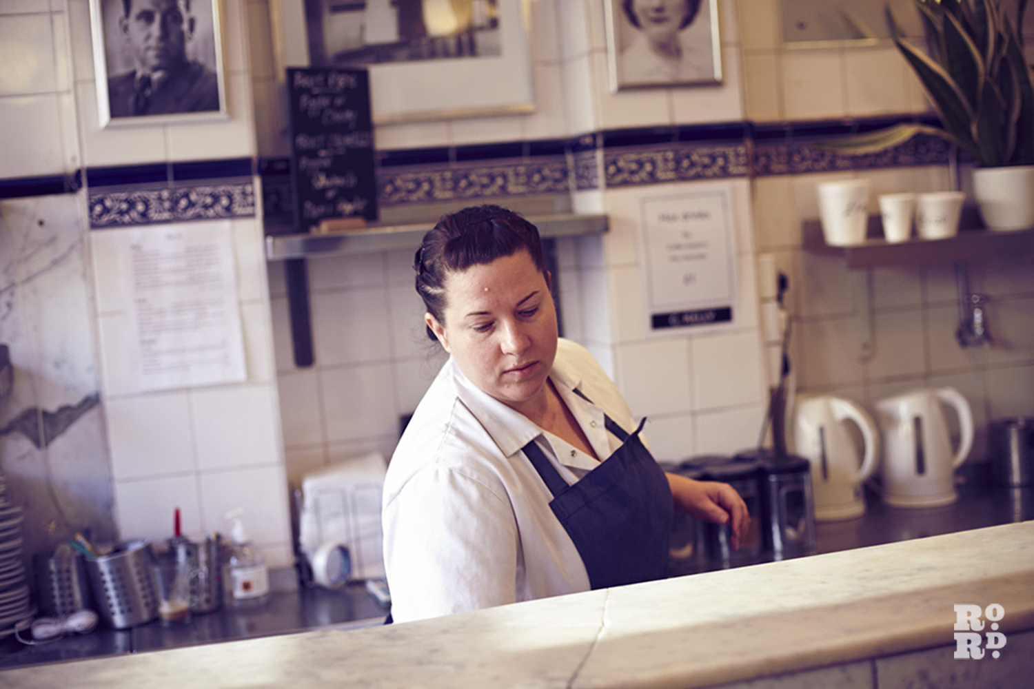 Leanne serving pie, mash and liquor at Roman Road's GKelly's pie and mash shop, East London