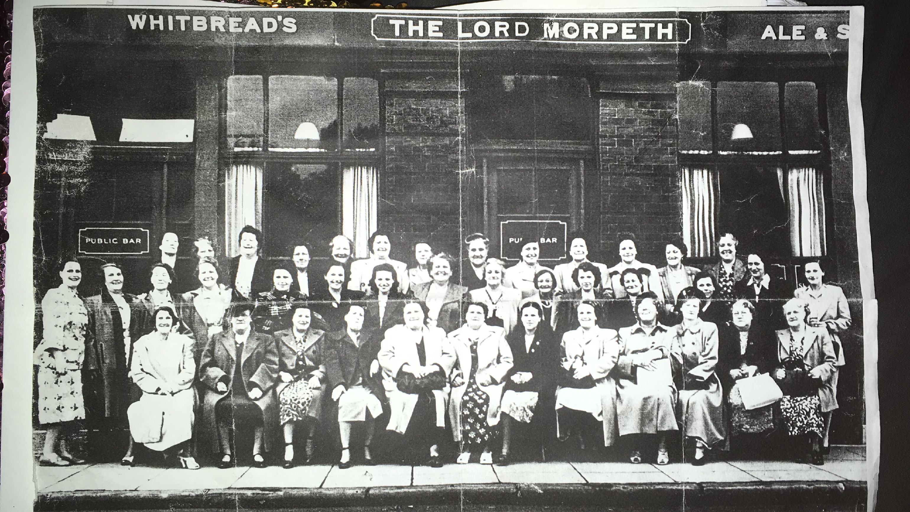 Black and white photograph of East End Suffragettes outside the Lord Morpeth Public House
