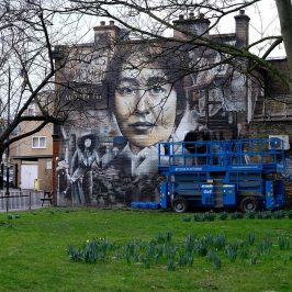 Large sepia tone mural of Sylvia Pankhurst and the Suffragettes on the side of the Lord Morpeth public house in Bow