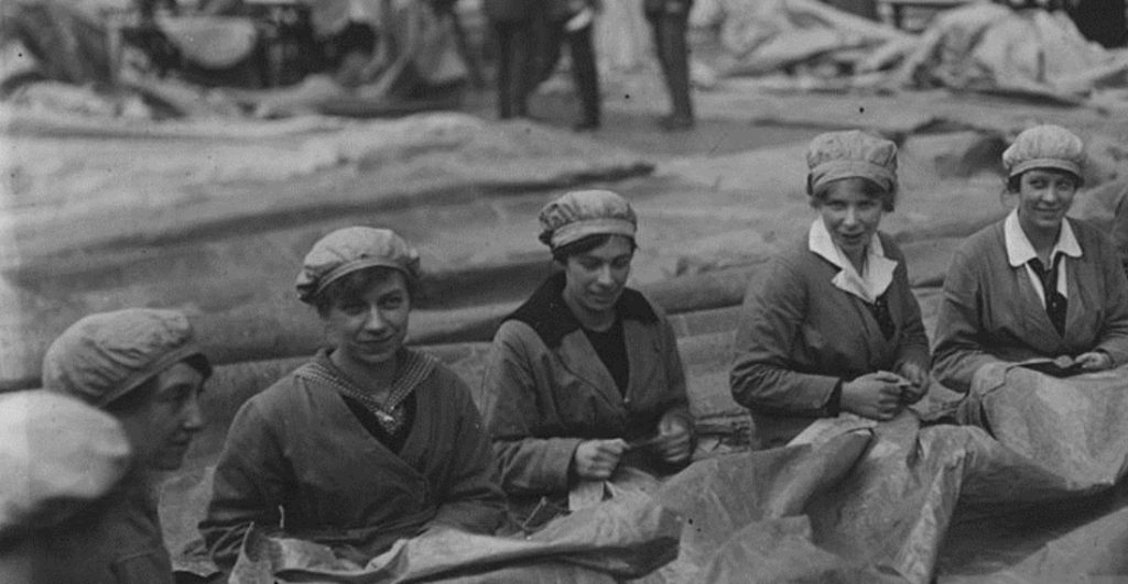 women sewing black and white photo