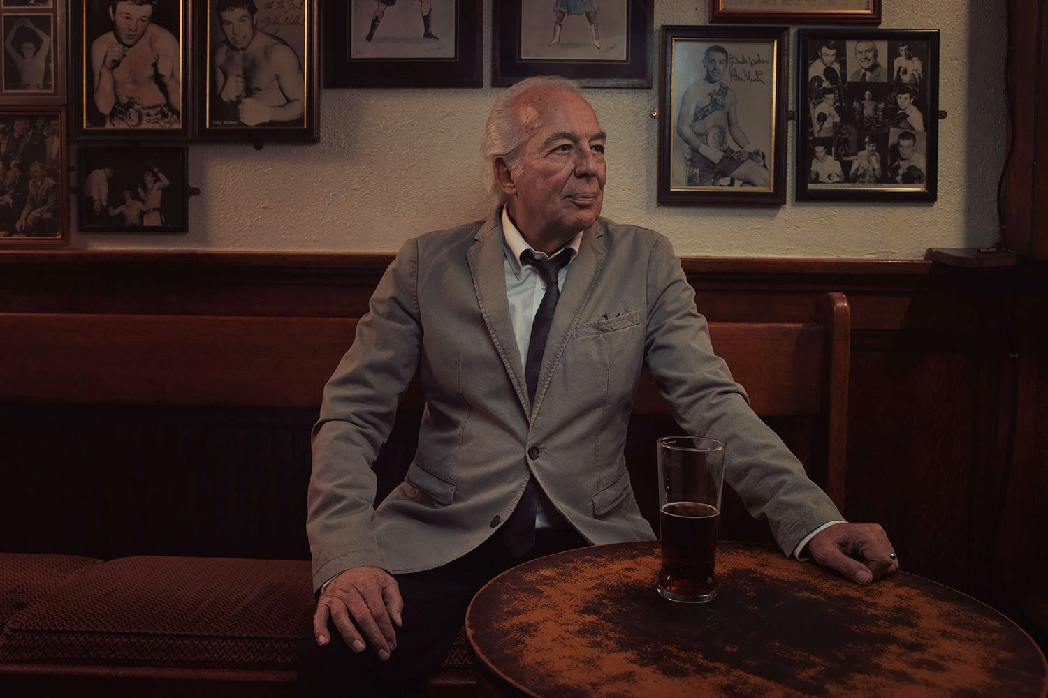 Man in jacket, pub table. Image from Last of the Old Crooners, Palm Tree pub by Tom Oldham