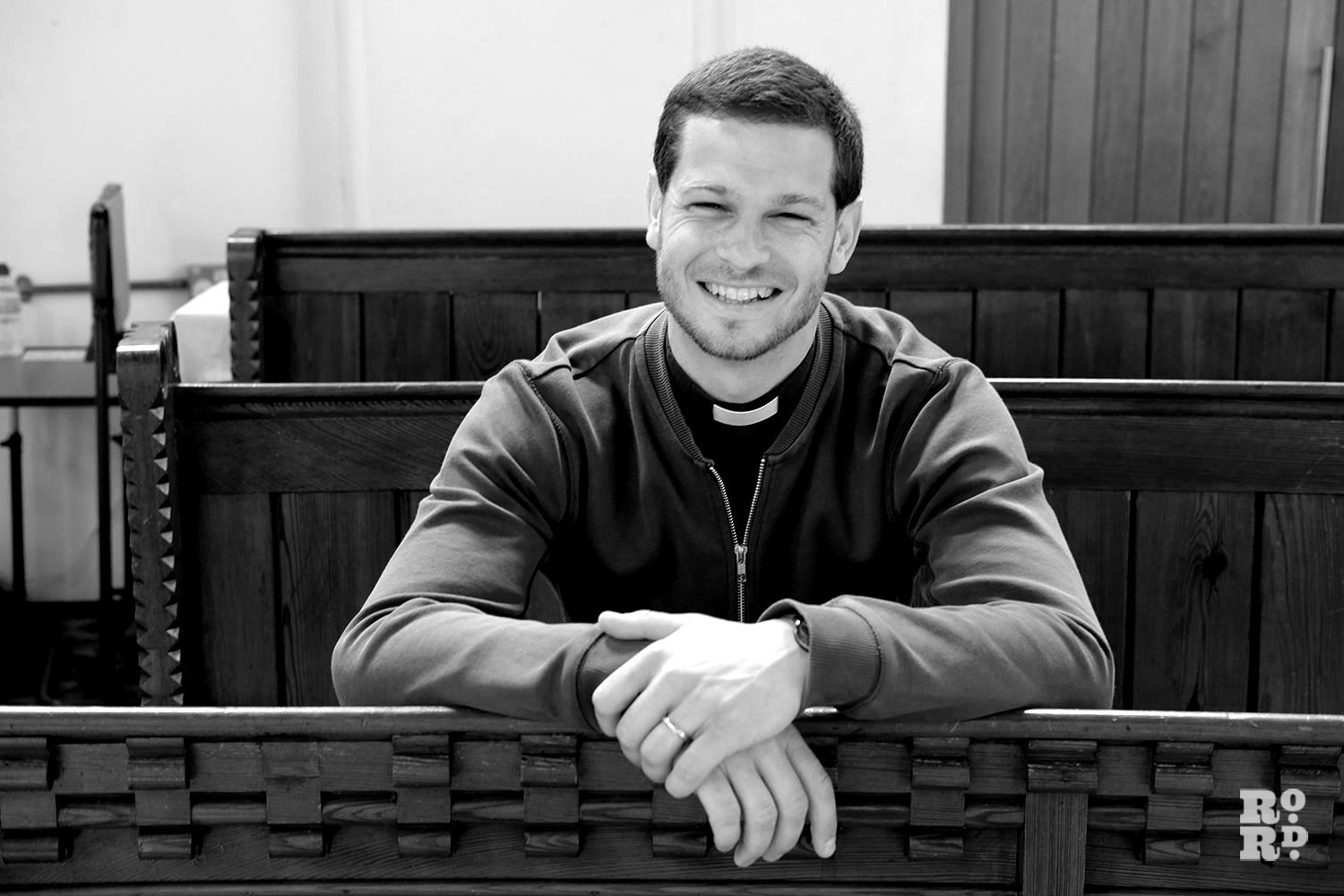 Reverend James Hughesdon in the pews at St Paul's Church, Old Ford, East London
