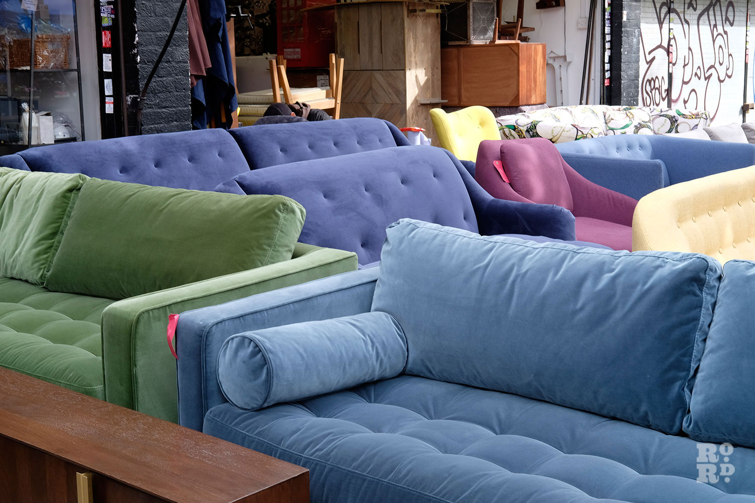Velvet Made.com sofas outside Lofty's furniture shop on Roman Road Market, Bow, East London