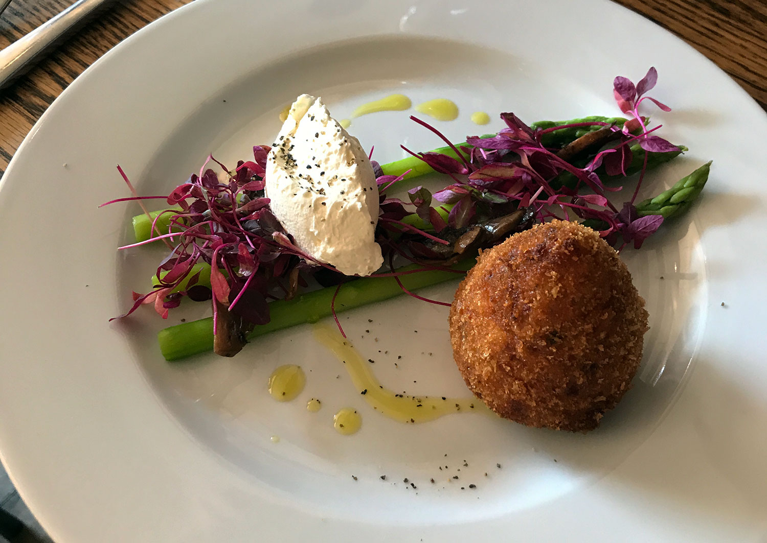 Arancini and asparagus on a plate at Bacaro on Roman Road