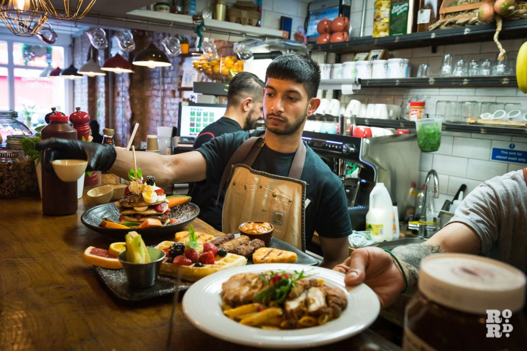 Chefs preparing brunch at Cafe East on Roman Road