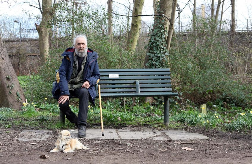 Keith and Hunter on a bench in the park