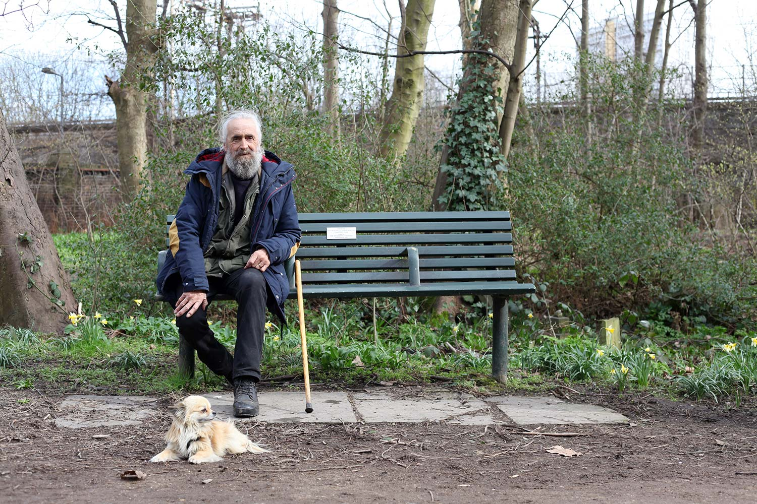 Keith and Hunter, his Chihuahua, on a bench in the Tower Hamlets Cemetery Park in East London