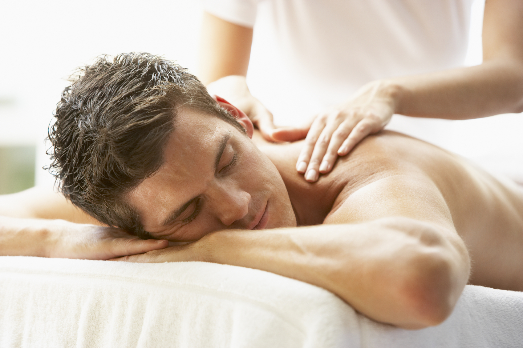 man getting massage in skin and tonic