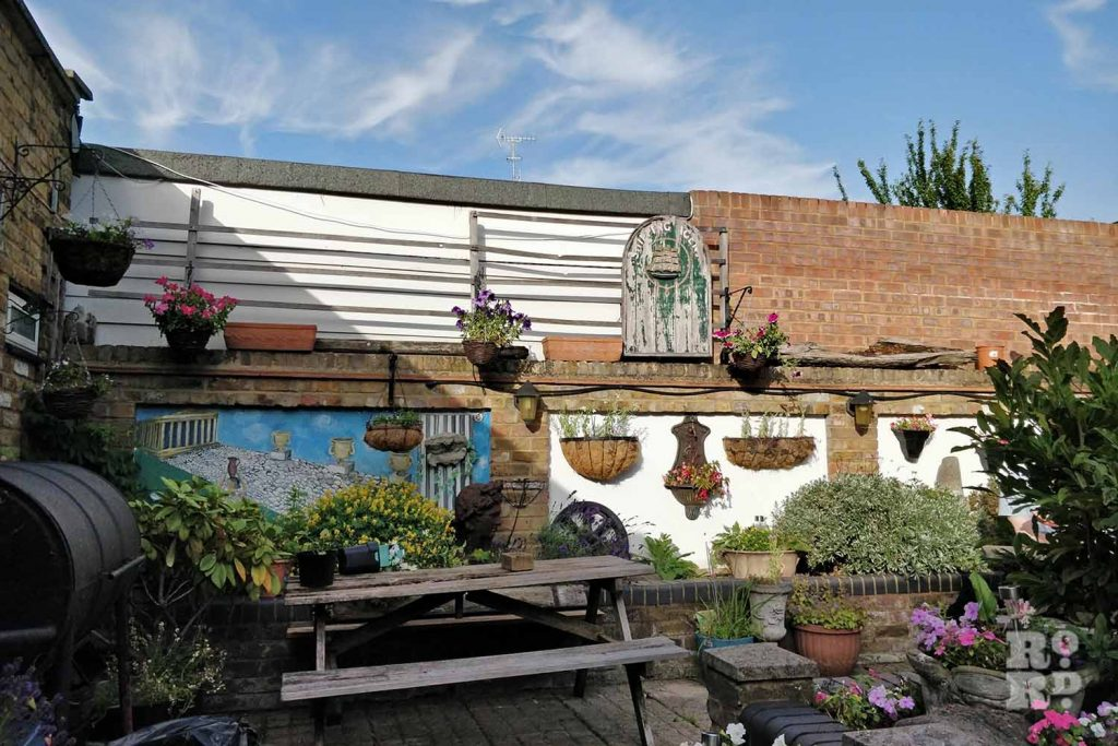 The beer garden in the Young Prince Pub on Roman Road on a sunny day