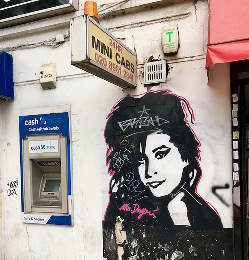Amy Winehouse graffiti on a wall on Grove Road, Mile End
