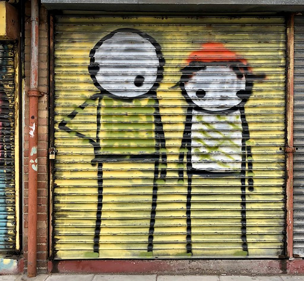 Stik grafiti on shop shutter on Bow Common Lane, East London