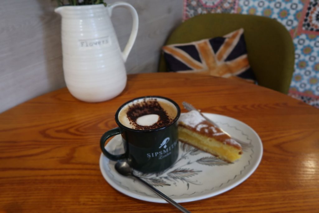 Coffee and cake on a table with flowers